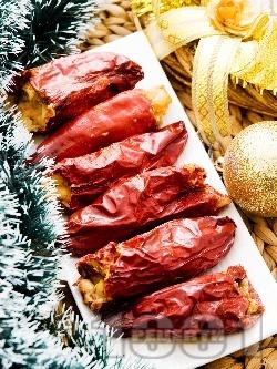 Коледни постни пълнени сушени чушки за Бъдни Вечер с боб и стафиди на фурна - снимка на рецептата